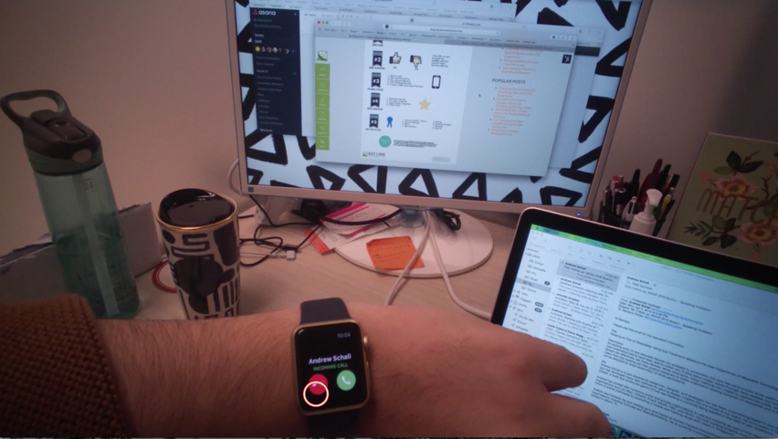 """picture of reuslts from an eyetracking device from a first person point of view showing the user looking down at their smart watch, with a focus on the """"don't pick up"""" option on the incoming phonecall"""