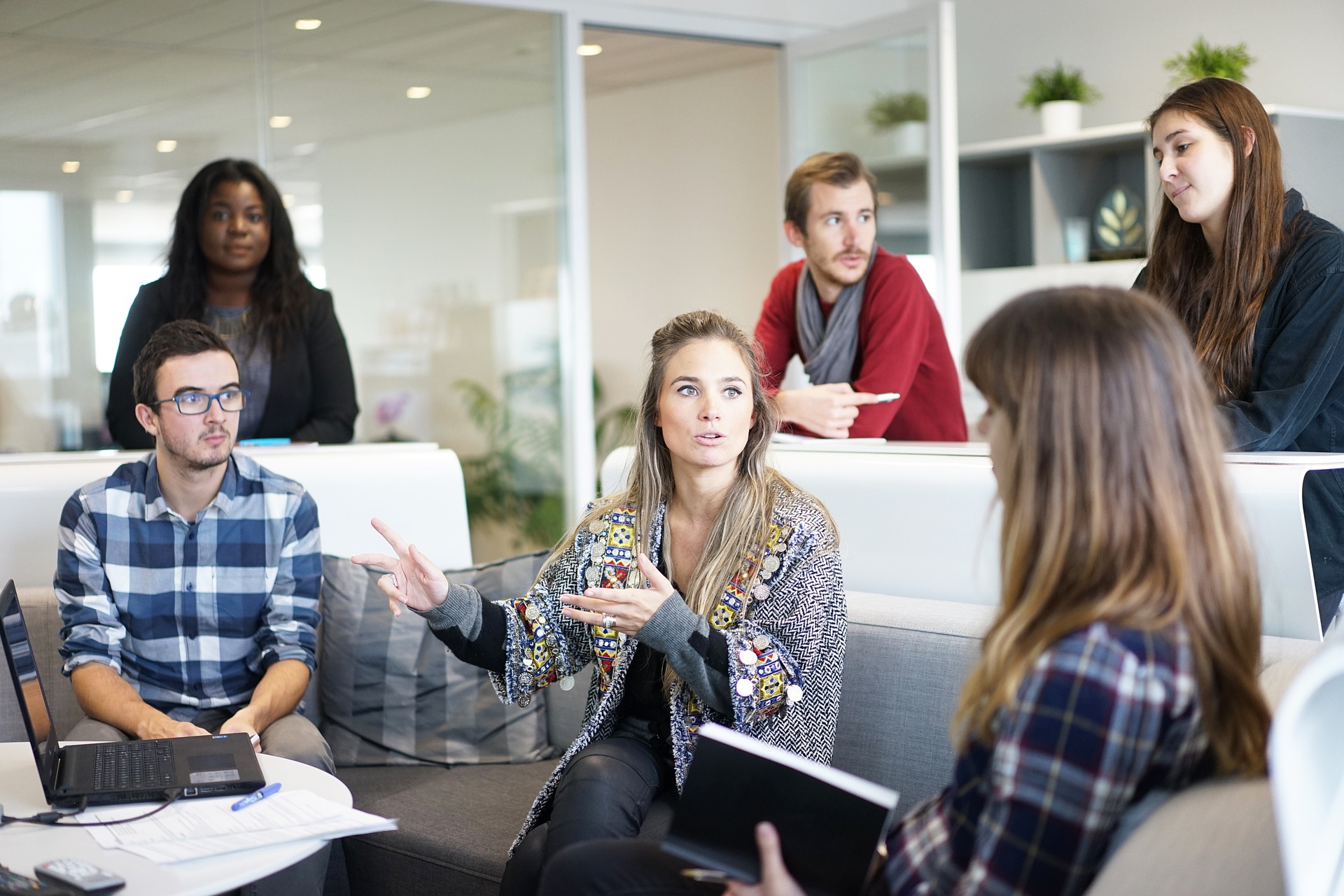 what-is-agile: a stock image of a group of people discussing